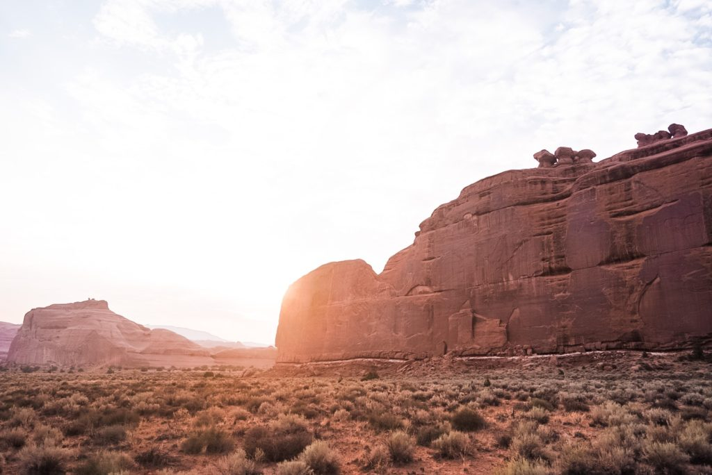 sunset behind wall in arches national park