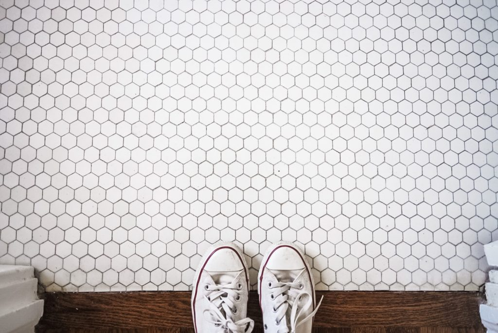 White tile floor with white chuck tennis shoes