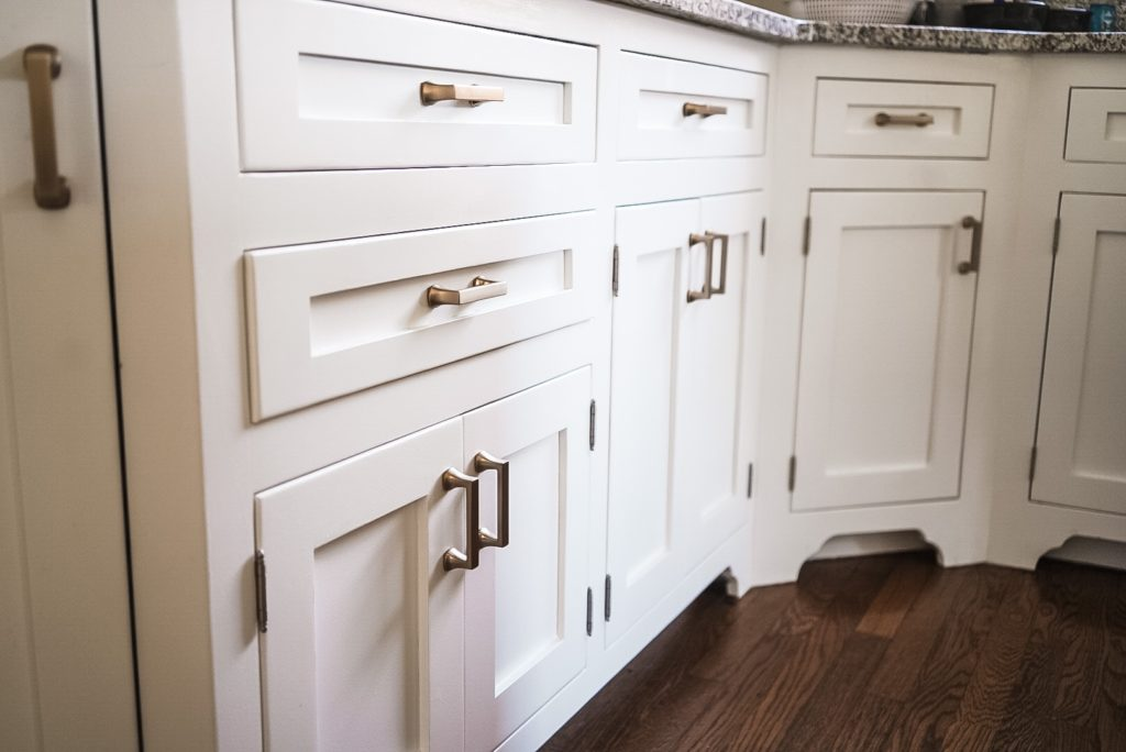 Kitchen cabinets with gold handles