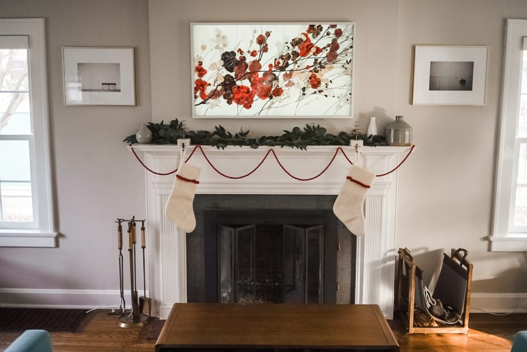 fireplace with two stockings hung with red beading on fire place