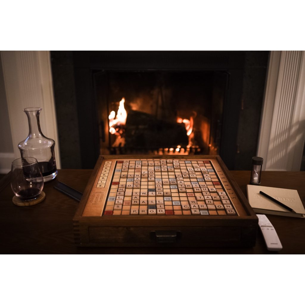 Scrabble board with fire in background