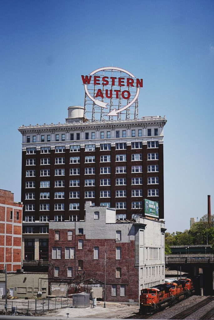 red brick building with western auto sign